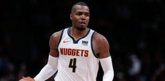 Denver Nuggets forward Paul Millsap (4) dribbles the ball in the third quarter against the Portland Trail Blazers in game one of the second round of the 2019 NBA Playoffs at the Pepsi Center.