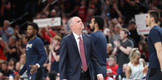 Denver Nuggets head coach Michael Malone looks at the scoreboard during a timeout Portland Trail Blazers in the first half of game three of the second round of the 2019 NBA Playoffs at Moda Center.