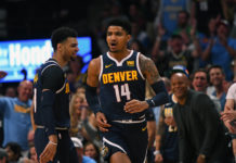 Denver Nuggets guard Gary Harris (14) celebrates a score with guard Jamal Murray (27) in the first quarter against the Portland Trail Blazers in game seven of the second round of the 2019 NBA Playoffs at Pepsi Center.