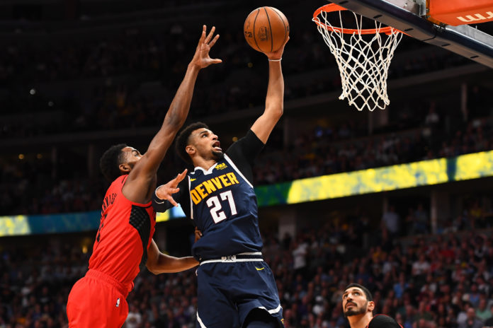 Denver Nuggets guard Jamal Murray (27) shoots past Portland Trail Blazers forward Maurice Harkless (4) in the second half in the second round of the 2019 NBA Playoffs at Pepsi Center.