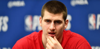Denver Nuggets center Nikola Jokic (15) speaks to the media following the loss to the Portland Trail Blazers in the second half in the second round of the 2019 NBA Playoffs at Pepsi Center.