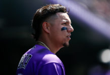 Colorado Rockies center fielder Yonathan Daza (31) looks on from the dugout in the fifth inning against the Arizona Diamondbacks at Coors Field.