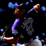 Colorado Rockies starting pitcher Peter Lambert (23) pitches during the seventh inning against the Chicago Cubs at Wrigley Field