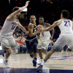Northern Colorado Bears guard Jordan Davis (0) drives to the basket as Arizona Wildcats center Dusan Ristic (14) and center Chance Comanche (21) defends during the