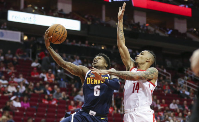 Denver Nuggets guard Brandon Goodwin (6) shoots against Houston Rockets guard Gerald Green (14) during the fourth quarter at Toyota Center.