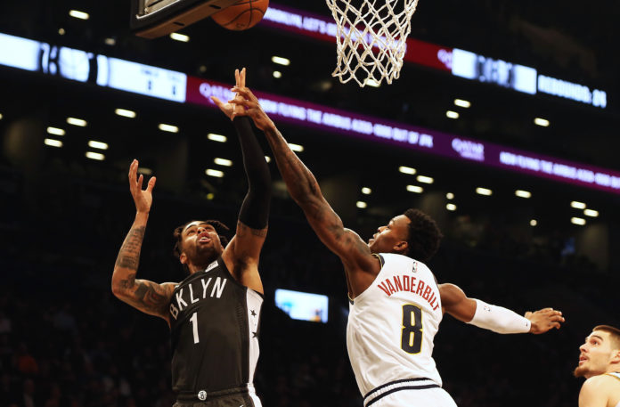 Brooklyn Nets guard D'Angelo Russell (1) shoots against Denver Nuggets forward Jarred Vanderbilt (8) during the second half at Barclays Center.