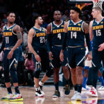 Denver Nuggets guard Monte Morris (11) and guard Jamal Murray (27) and forward Paul Millsap (4) and guard Gary Harris (14) and center Nikola Jokic (15) in the fourth quarter against the Dallas Mavericks at the Pepsi Center.