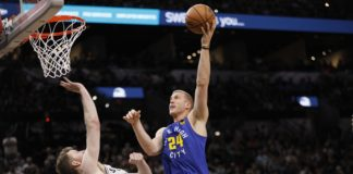 019; San Antonio, TX, USA; Denver Nuggets power forward Mason Plumlee (24) shoots the ball over San Antonio Spurs center Jakob Poeltl (25) in game six of the first round of the 2019 NBA Playoffs at AT&T Center.