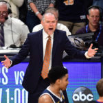 Denver Nuggets head coach Michael Malone reacts to a foul called in the fourth quarter against the San Antonio Spurs in game seven of the first round of the 2019 NBA Playoffs at the Pepsi Center.