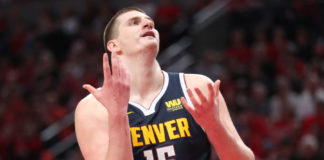 Denver Nuggets center Nikola Jokic (15) reacts after the Nuggets were called for a foul against the Portland Trail Blazers in the second half of game four of the second round of the 2019 NBA Playoffs at Moda Center.