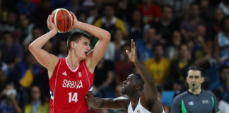 Rio de Janeiro, Brazil; Serbia center Nikola Jokic (14) looks to pass while guarded by United States forward Draymond Green (14) during the game in the preliminary round of the Rio 2016 Summer Olympic Games at Carioca Arena 1.