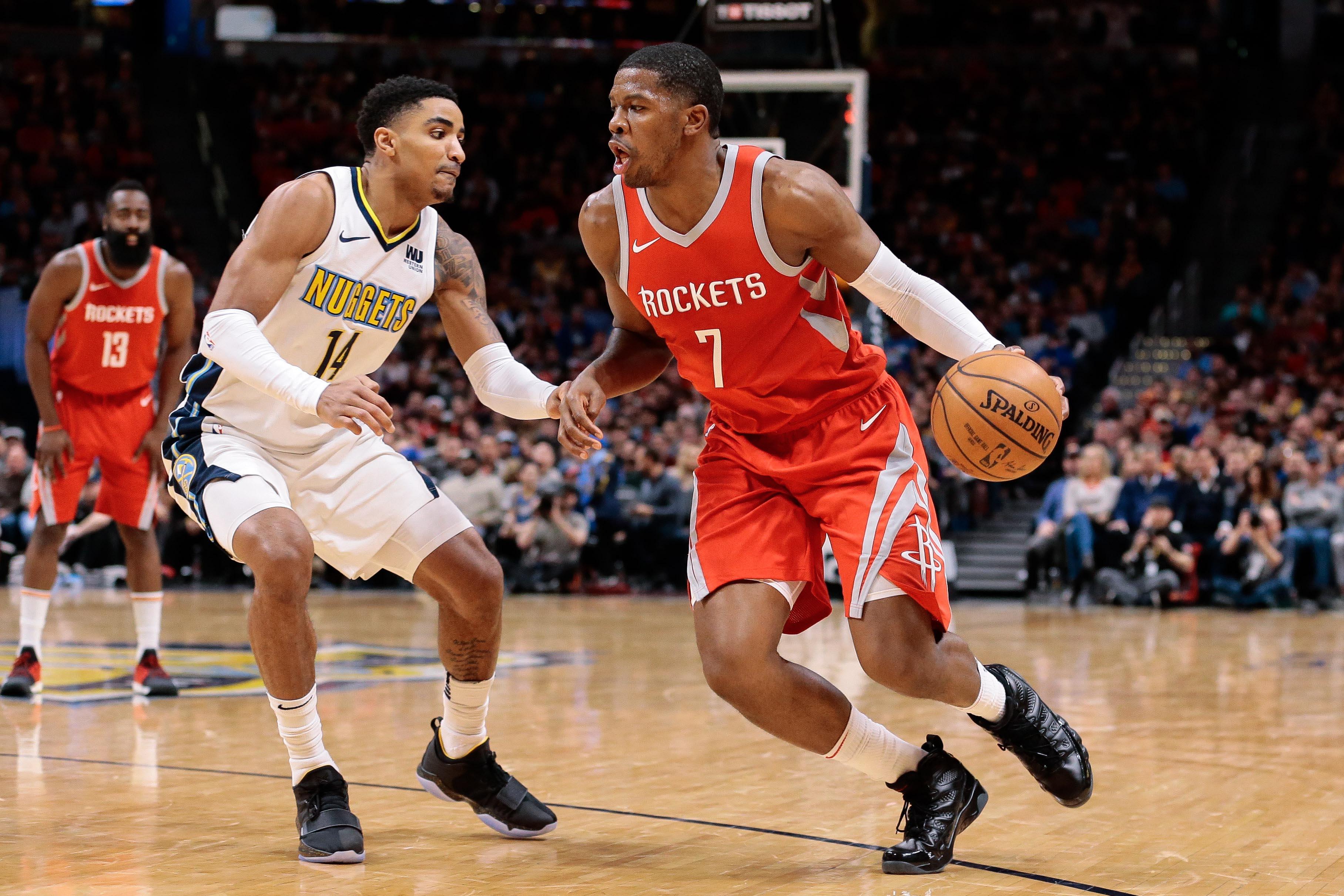 Denver Nuggets guard Gary Harris (14) guards Houston Rockets guard Joe Johnson (7) in the fourth quarter at the Pepsi Center.