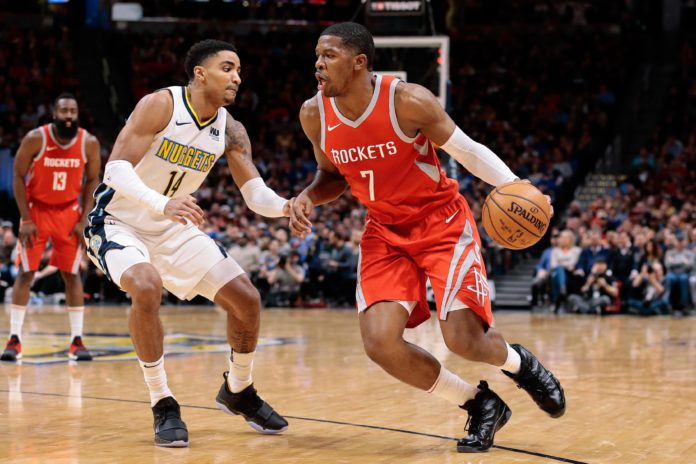 Denver Nuggets guard Gary Harris (14) guards Houston Rockets guard Joe Johnson (7) in the fourth quarter at the Pepsi Center.