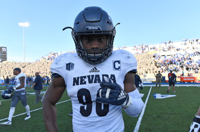 Nevada Wolf Pack linebacker Malik Reed (90) celebrates the win over the Air Force Falcons at Falcon Stadium.