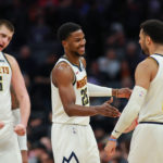 Denver Nuggets guard Jamal Murray (27) celebrates with guard Malik Beasley (25) and center Nikola Jokic (15) during the fourth quarter against the Sacramento Kings at Golden 1 Center.