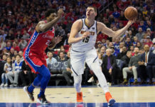 Denver Nuggets center Nikola Jokic (15) shoots the ball past Philadelphia 76ers center Joel Embiid (21) during the first quarter at Wells Fargo Center.