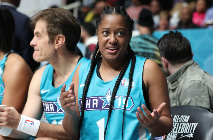 Home Team player Rapsody reacts on the bench during the third quarter against the Away Team at Bojangles Coliseum .