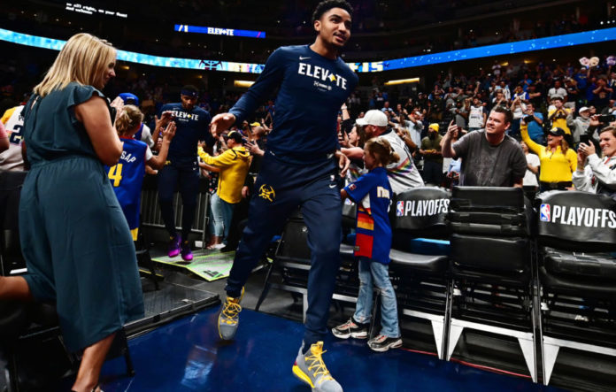 Denver Nuggets guard Gary Harris (14) runs onto the court for warm ups before the game against the Portland Trail Blazers in game seven of the second round of the 2019 NBA Playoffs at Pepsi Center.