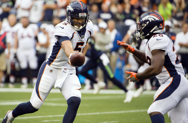 Denver Broncos quarterback Joe Flacco (5) hands off to running back Royce Freeman (28) during the first half agains the Seattle Seahawks at CenturyLink Field.
