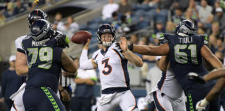 Denver Broncos quarterback Drew Lock (3) throws a pass under pressure from Seattle Seahawks defensive tackle Jay-Tee Tiuli (61) and nose tackle Bryan Mone (79) in the fourth quarter at CenturyLink Field. The Seahawks won 22-14.