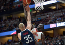 Spain center Ilimane Diop (12) moves to the basket against USA center Mason Plumlee (35) during the first half of an exhibition game at Honda Center.