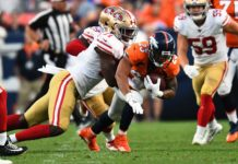 San Francisco 49ers defensive tackle Jullian Taylor (71) tackles Denver Broncos running back Devontae Booker (23) in the second quarter at Broncos Stadium at Mile High.