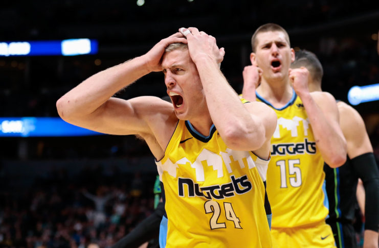 Denver Nuggets center Mason Plumlee (24) and center Nikola Jokic (15) react after a call in the fourth quarter against the Dallas Mavericks at the Pepsi Center.