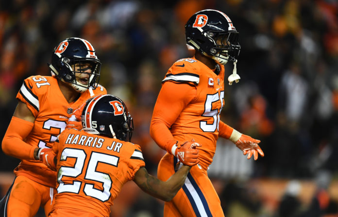 Denver Broncos outside linebacker Von Miller (58) and inside linebacker Todd Davis (51) and cornerback Chris Harris (25) celebrate a turnover over in in the fourth quarter against the Pittsburgh Steelers at Broncos Stadium at Mile High.