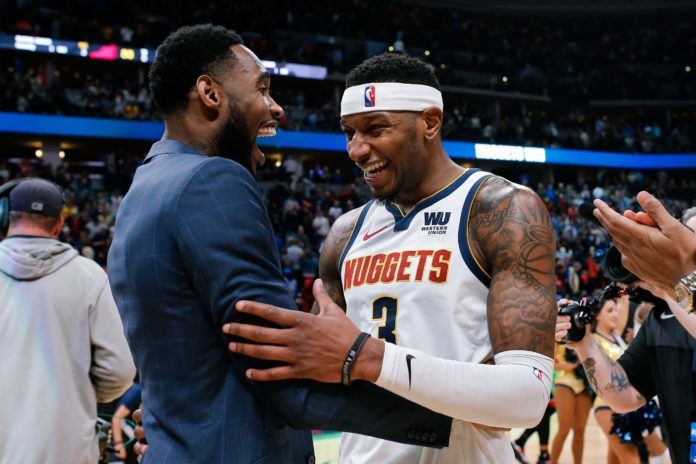 Denver Nuggets forward Torrey Craig (3) celebrates with guard Will Barton after the game against the Toronto Raptors at the Pepsi Center.