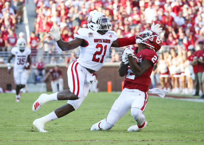 Oklahoma Sooners wide receiver CeeDee Lamb (2) makes a catch over South Dakota Coyotes defensive back Phillip Powell (21) during the first quarter at Gaylord Family - Oklahoma Memorial Stadium