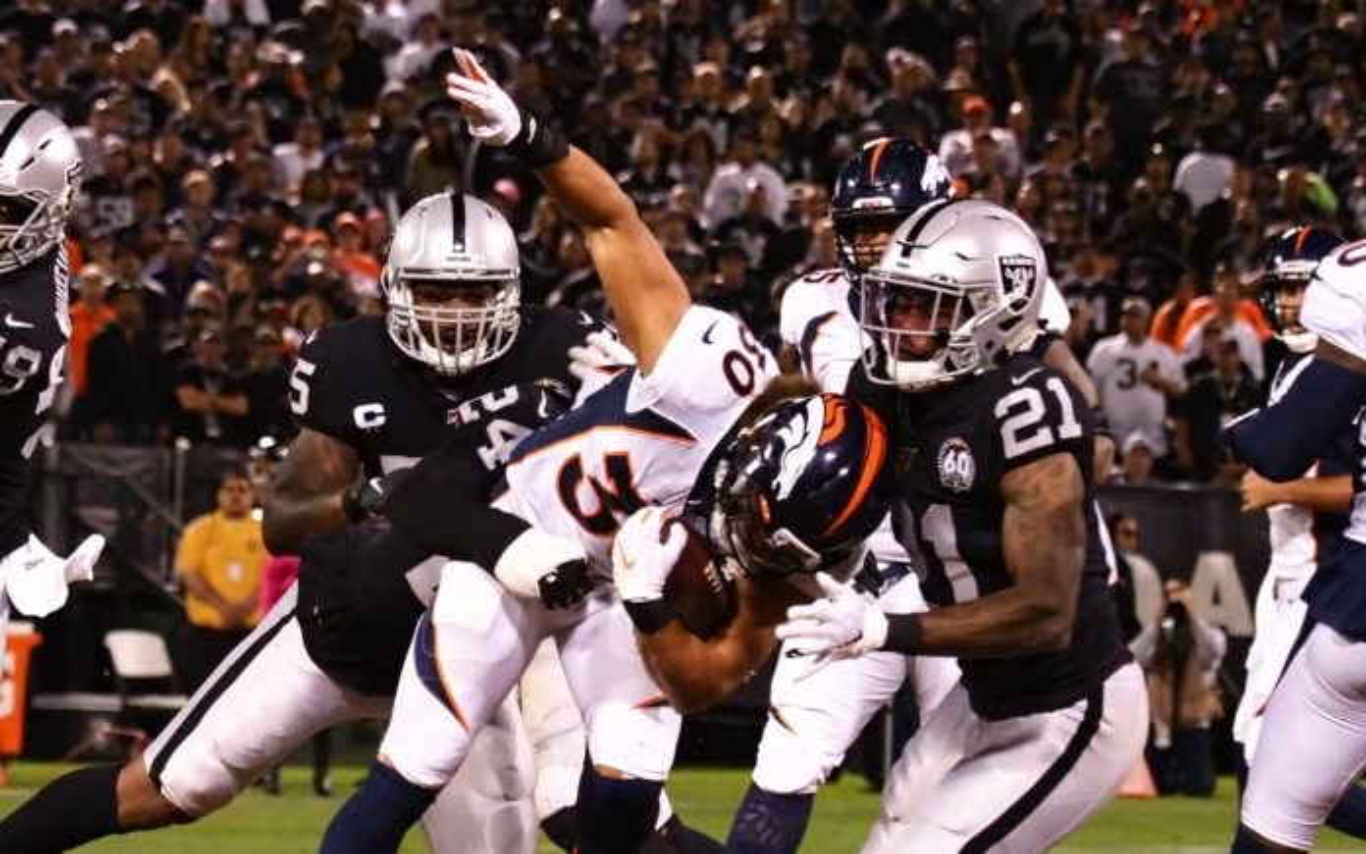 Phillip Lindsay tackled. Credit: Kelley L. Cox, USA TODAY Sports.
