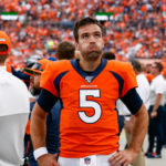 Denver Broncos quarterback Joe Flacco (5) reacts on the sidelines in the fourth quarter against the Chicago Bears at Empower Field at Mile High.