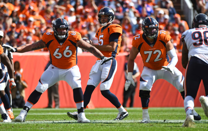 Denver Broncos offensive tackle Dalton Risner (66) and offensive tackle Garett Bolles (72) block for quarterback Joe Flacco (5) in the fourth quarter against the Chicago Bears at Empower Field at Mile High.