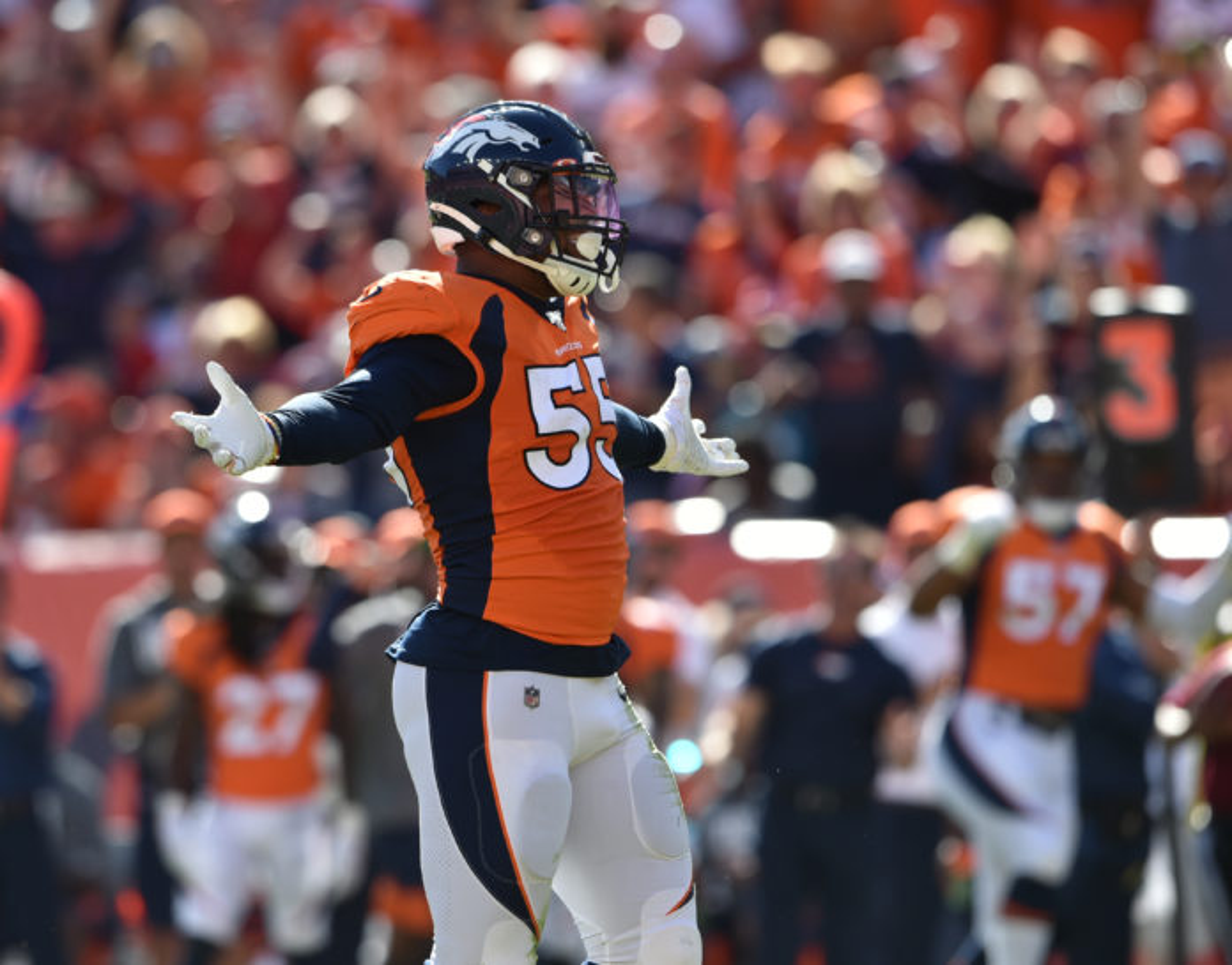 Denver Broncos outside linebacker Bradley Chubb (55) celebrates sacking Jacksonville Jaguars quarterback Gardner Minshew (15) in the second quarter at Empower Field at Mile High.