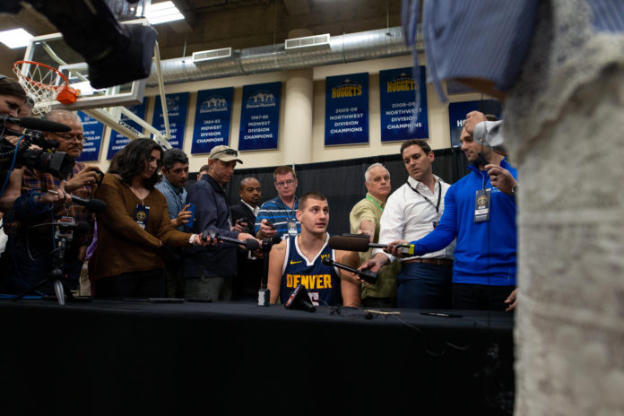 Denver Nuggets center Nikola Jokic (15) addresses questions during media day at the Pepsi Center.