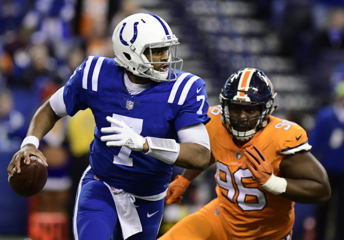 Indianapolis quarterback Jacoby Brissett (17) runs out of the pocket in the fourth quarter against the Denver Broncos at Lucas Oil Stadium.