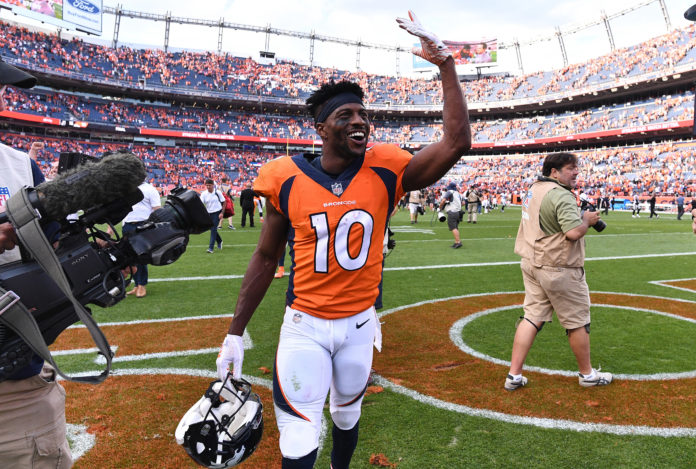 Denver Broncos wide receiver Emmanuel Sanders (10) celebrates the win over the Oakland Raiders at Broncos Stadium at Mile High.
