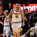 Denver Nuggets forward Juan Hernangomez (41) reacts following his three point basket in the fourth quarter against the Portland Trail Blazers in game five of the second round of the 2019 NBA Playoffs at Pepsi Center.
