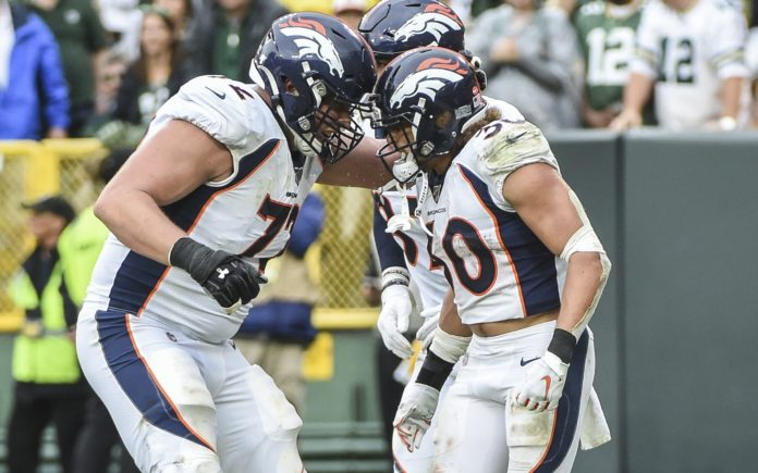 Bolles and Phillip Lindsay celebrate. Credit: Benny Sieu, USA TODAY Sports.