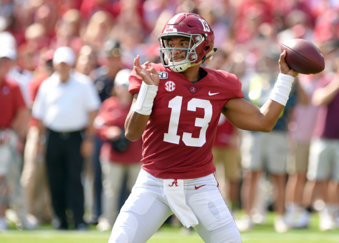 Alabama Crimson Tide quarterback Tua Tagovailoa (13) drops back to pass against during the first quarter at Bryant-Denny Stadium.