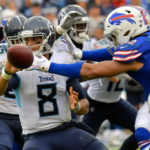 Tennessee Titans quarterback Marcus Mariota (8) shuttles the ball out to Titans running back Derrick Henry (22) (not pictured) against Buffalo Bills defensive end Darryl Johnson (92) during the second half at Nissan Stadium.