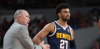 Denver Nuggets head coach Michael Malone talks with guard Jamal Murray (27) in the second half at Veterans Memorial Coliseum.