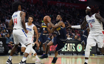 Denver Nuggets guard Will Barton (5) drives between LA Clippers guard Terance Mann (14) and forward Montrezl Harrell (5) during the second half at Staples Center.