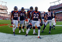 Denver Broncos defensive back Kareem Jackson (22) celebrates with teammates after his interception in the fourth quarter against the Tennessee Titans at Empower Field at Mile High.