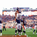 Denver Broncos guard Connor McGovern (60) celebrates the touchdown of running back Phillip Lindsay (30) in the third quarter against the Tennessee Titans at Empower Field at Mile High.