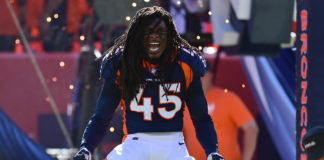 Denver Broncos linebacker Alexander Johnson (45) enters the field before the game against the Tennessee Titans at Empower Field at Mile High.