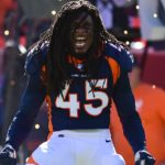 "Alexander ""Dino"" Johnson roars before the Broncos - Titans game last week. Credit: Ron Chenoy, USA TODAY Sports."