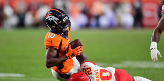 Kansas City Chiefs cornerback Morris Claiborne (20) tackles Denver Broncos wide receiver Emmanuel Sanders (10) in the second quarter at Empower Field at Mile High.