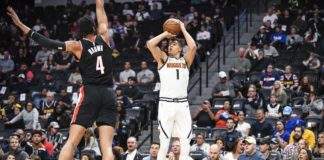 Denver Nuggets forward Michael Porter Jr. (1) lines up a shot over Portland Trail Blazers center Moses Brown (4) during the second half at Pepsi Center.