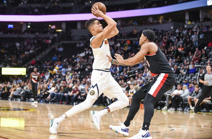 Denver Nuggets forward Michael Porter Jr. (1) makes a move around Portland Trail Blazers guard Troy Caupain (10) during the second half at Pepsi Center.